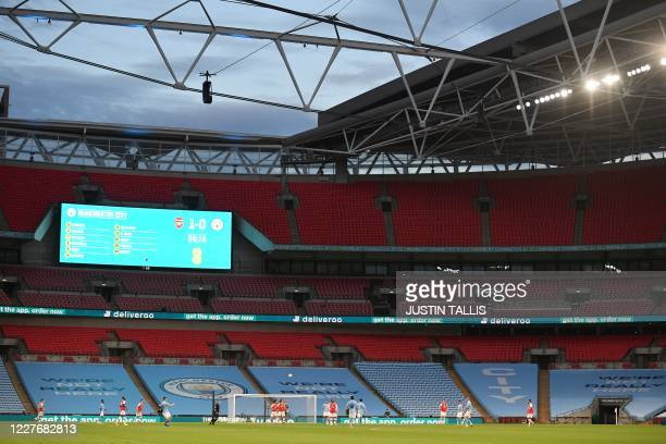 General view shows the English FA Cup semi-final football match between Arsenal and Manchester City at Wembley Stadium in London, on July 18, 2020. /...