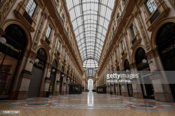 A general view shows the entrance of a deserted Galleria Vittorio Emanuele II shopping mall in center Milan on March 31 during the country's lockdown...