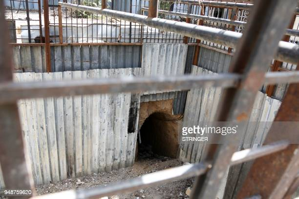 A general view shows the exterior of an abandoned underground prison used by Jaish alIslam fighters in the former rebelheld Syrian town of Douma on...
