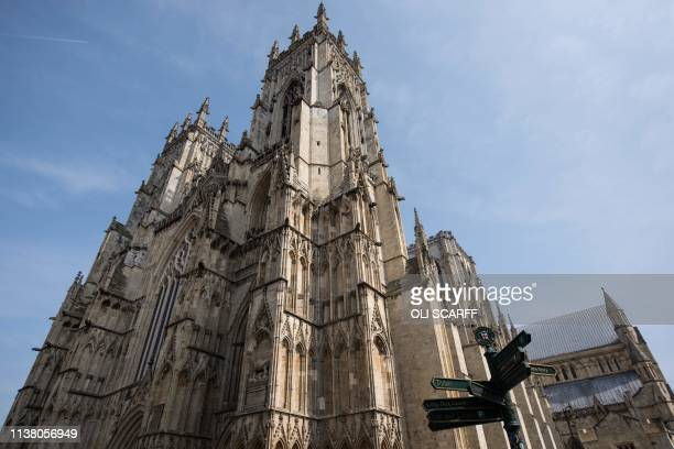 General view shows the exterior of York Minster in York, northern England, on April 18, 2019. - The stories of York Minster and Notre-Dame have...
