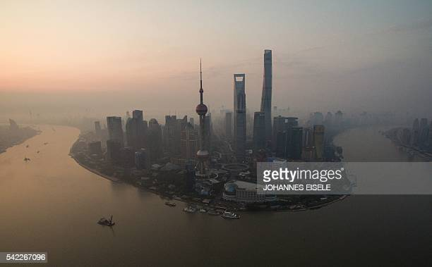 TOPSHOT A general view shows the financial district of Lujiazui in Shanghai early on June 23 2016 / AFP PHOTO / JOHANNES EISELE