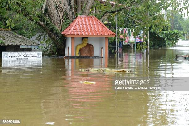 A general view shows the floodwaters in Nagoda in Kalutara district on May 29 2017 Sri Lanka's monsoon toll climbed to 164 with the discovery of more...