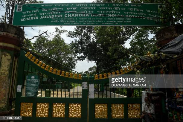 A general view shows the gate of the Indian Botanical Garden that has endured damages on trees and flora following the landfall of cyclone Amphan in...