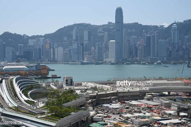 A general view shows the harbourfront West Kowloon train station of the High Speed Rail Link to Guangzhou and the skyline of Hong Kong island on...