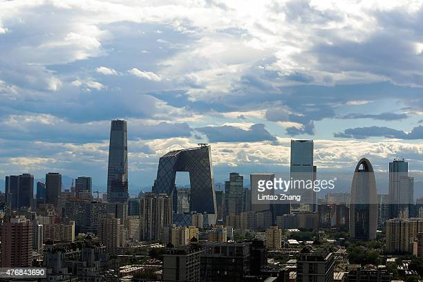 General view shows the headquarter of China Central Television amid the Beijing skyline at central business district on June 12, 2015 in Beijing,...