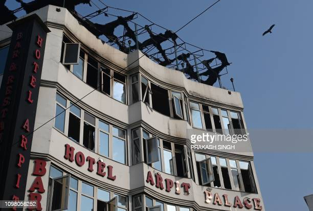 A general view shows the Hotel Arpit Palace after a fire broke out on its premises in New Delhi on February 12 2019 At least 17 people died on...