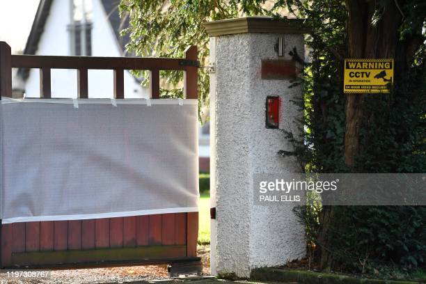 A general view shows the intercom unit with red spray paint defacing it with sheeting screening the defaced gate at the home of Manchester United...
