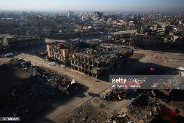 TOPSHOT A general view shows the Iraqi city of Mosul on January 8 six months after Iraqi forces seized the country's second city from Islamic State...