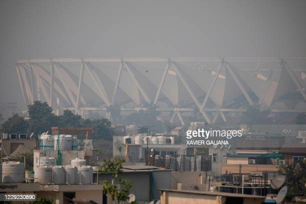 General view shows the Jawaharlal Nehru Stadium under heavy smog conditions in New Delhi on October 23, 2020. - New Delhi was blanketed in noxious...