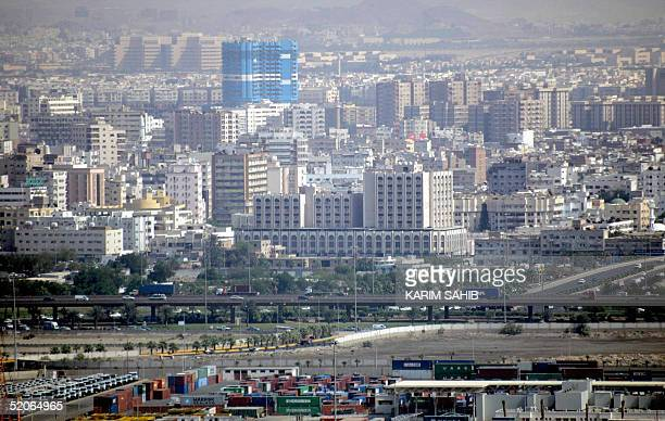 A general view shows the Jeddah's Islamic Port with the Saudi Red Sea city in the background 24 January 2005 AFP PHOTO/KARIM SAHIB