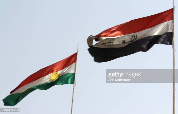 A general view shows the Kurdish and Iraqi flags flying next to each other in Kirkuk on September 26 after a curfew on parts of the city was lifted...