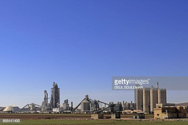 A general view shows the Lafarge Cement Syria cement plant in Jalabiya some 30 kms from Ain Issa in northern Syria in February 19 2018 The choice to...