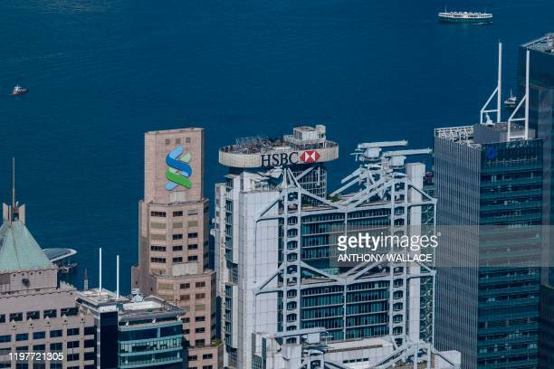 General view shows the local HSBC headquarters building in Hong Kong on January 31 which today announced it would shut 24 branches across the city...