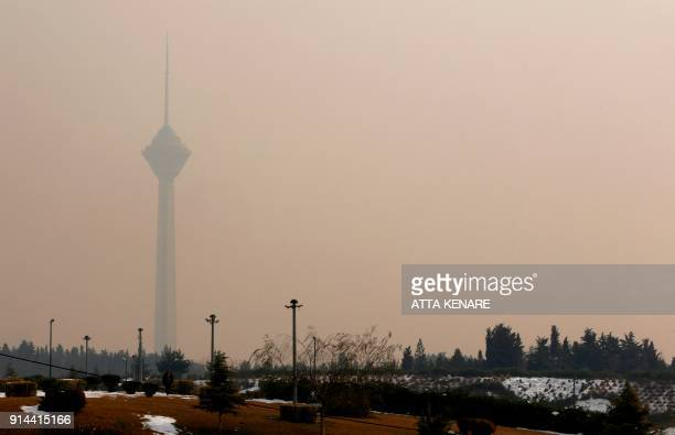 A general view shows the Milad telecommunications tower in the distant behind a blanket of thick smog as heavy pollution hit new highs in Tehran on...