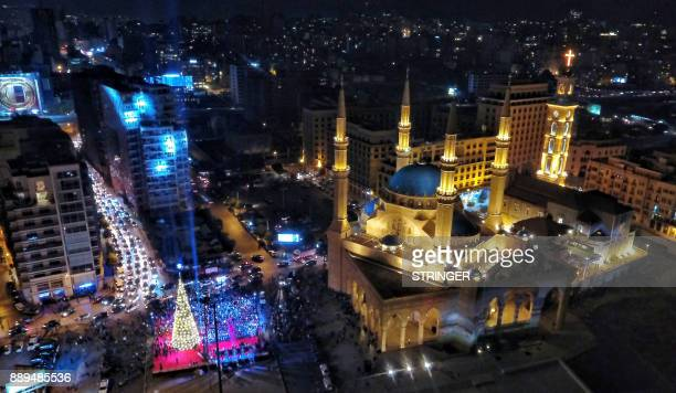 A general view shows the Mohammad alAmin mosque during an event to turn on the lights of a Christmas tree in downtown Beirut on December 10 2017 /...