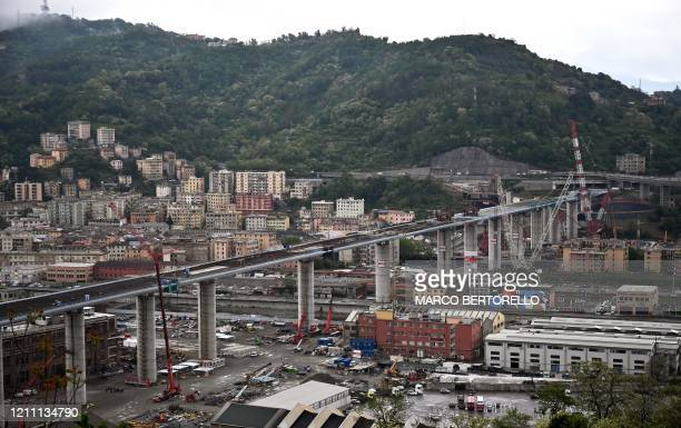 General view shows the new Genoa bridge, as the last 44-meter long span has been almost completed hoisted between columns 10 and 11 on the bridge's...