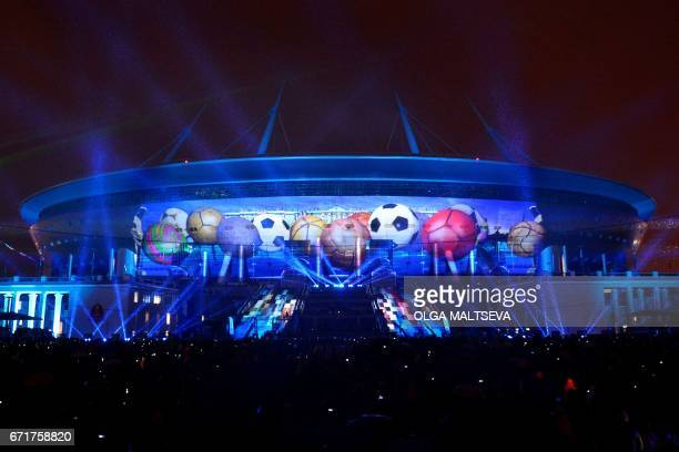 A general view shows the new 'Saint Petersburg' football stadium being illuminated during light show in St Petersburg on April 22 2017 The...