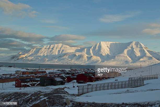 A general view shows the Norwegian town of Longyearbyen on March 7 2012 with the Hiortfjellet mountain in the background AFP PHOTO / BERIT ROALD...