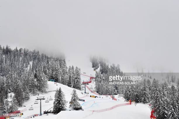 General view shows the Olympia delle Tofane slope as foggy weather covers the mountain, as the start of the Women's Super G event has been lowered...