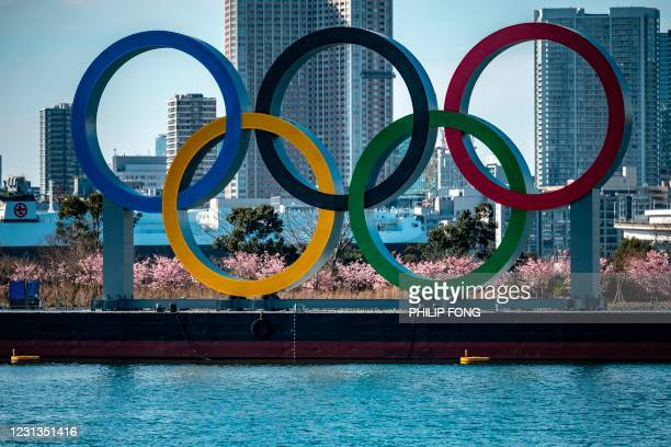 General view shows the Olympic rings on display at the Odaiba waterfront in Tokyo on February 24, 2021.