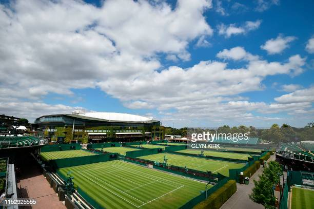 A general view shows the outer courts at The All England Tennis Club in Wimbledon southwest London on June 30 on the eve of the start of the 2019...