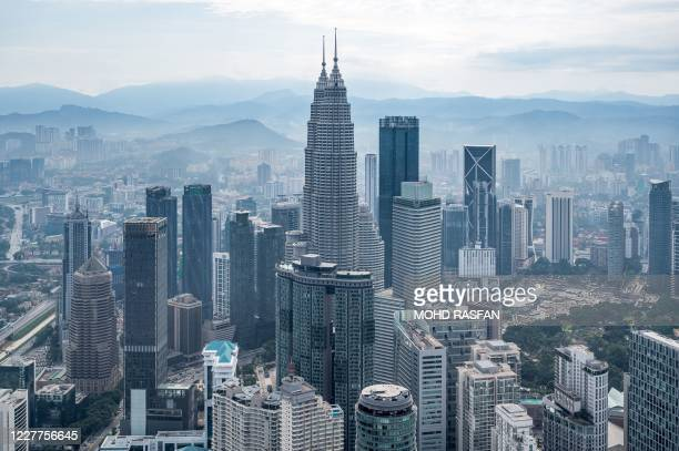 General view shows the Petronas Twin Towers and other commercial buildings, as seen from KL Tower, in Kuala Lumpur on July 24, 2020.