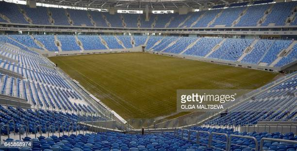 A general view shows the pitch at the new football stadium at Krestovsky island also known as the Zenit Arena in Saint Petersburg on February 27 2017...