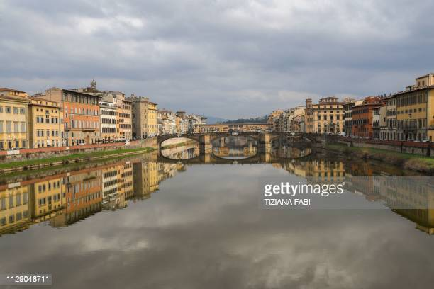 General view shows the Ponte Vecchio medieval arch bridge over the Arno river on March 7, 2019 in Florence, Tuscany.