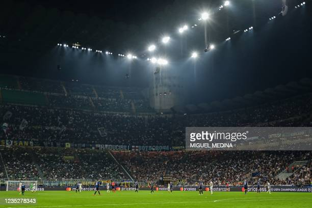 General view shows the public in the tribunes during the UEFA Champions League Group D football match between Inter Milan and Real Madrid on...