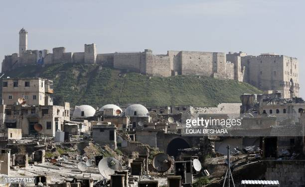 A general view shows the Saqatiya market during restoration and the Citadel of Aleppo in the old quarter of Syria's second city of Aleppo on February...