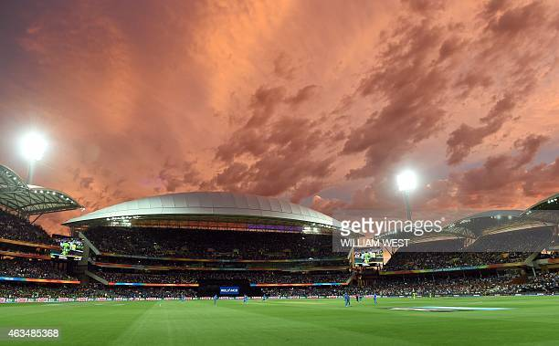 A general view shows the scene as the sun sets at the Adelaide Oval during the 2015 Cricket World Cup match between India and Pakistan in Adelaide on...
