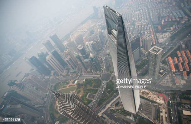 A general view shows the Shanghai World Financial Center and the skyline of the Lujiazui Financial District in Pudong seen from the 109th floor of...