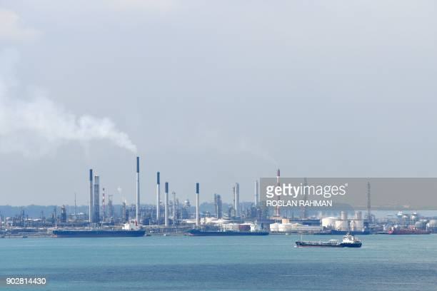A general view shows the Shell petroleum refinery on Bukom island in Singapore on January 9 2018 Singaporean authorities have arrested 17 men for...