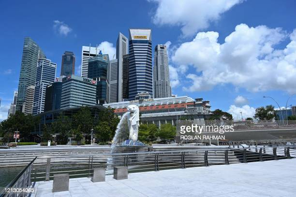 General view shows the Singapore skyline behind the Merlion park on May 15, 2020.