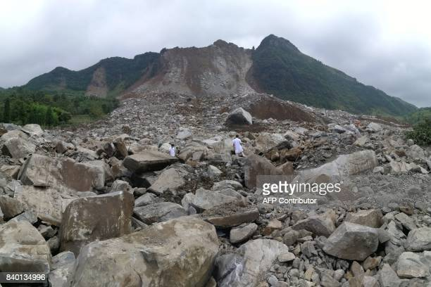 A general view shows the site of a landslide in Bijie in China's southwestern Guizhou province on August 28 2017 A landslide struck some 34 homes in...