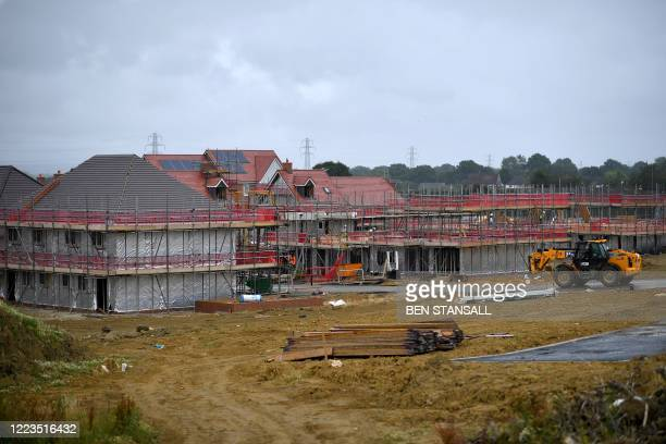 General view shows the site of a new build housing development in Paddock Wood, Kent, in southeast England, on June 30 - Britain's Prime Minister...