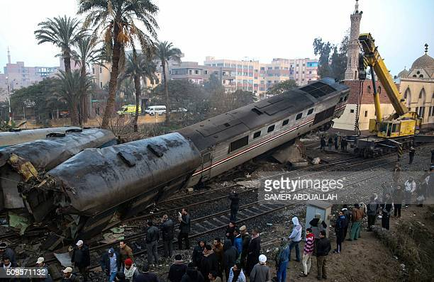 TOPSHOT A general view shows the site where a train crashed near Beni Suef some 180 kilometres south of the capital Cairo on February 11 2016 At...