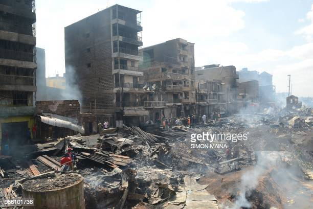 A general view shows the smouldering debris following a fire that gutted the timber dealership at the Gikomba market and nearby homes in central...