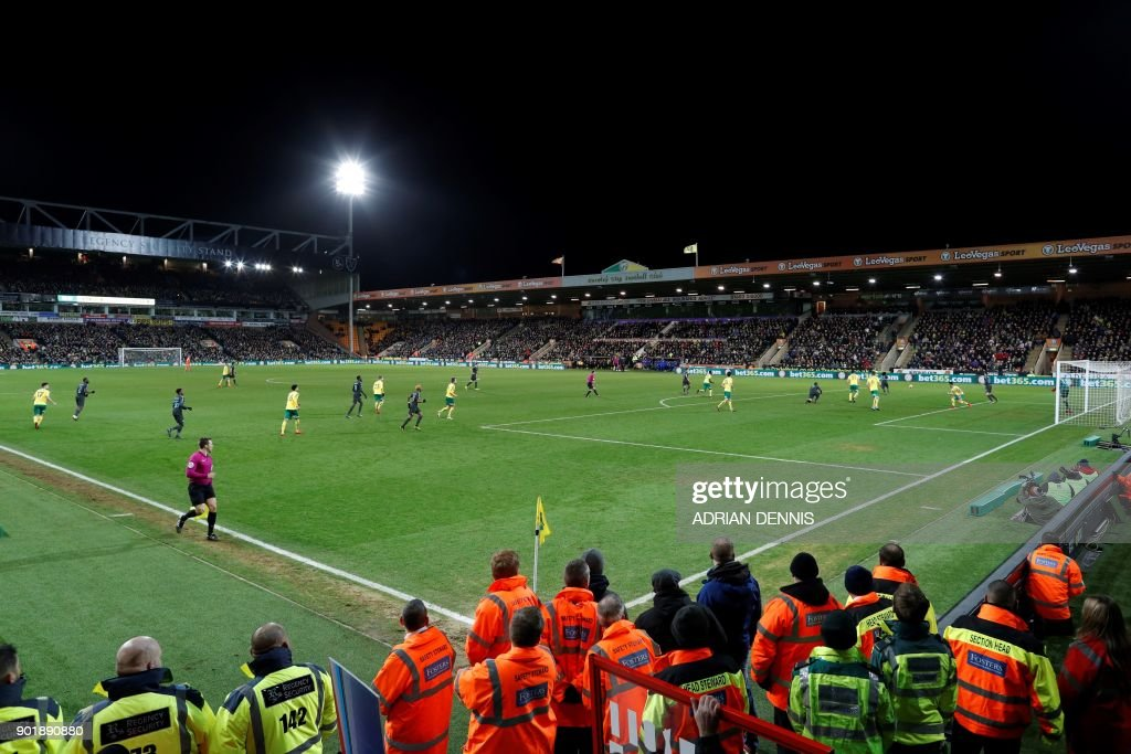 A general view shows the stewards and security at the side of the pitch during the English FA Cup third round football match between Norwich City and Chelsea at Carrow Road in Norwich, north east England on January 6, 2018. / AFP PHOTO / Adrian DENNIS / RESTRICTED TO EDITORIAL USE. No use with unauthorized audio, video, data, fixture lists, club/league logos or 'live' services. Online in-match use limited to 75 images, no video emulation. No use in betting, games or single club/league/player publications. /