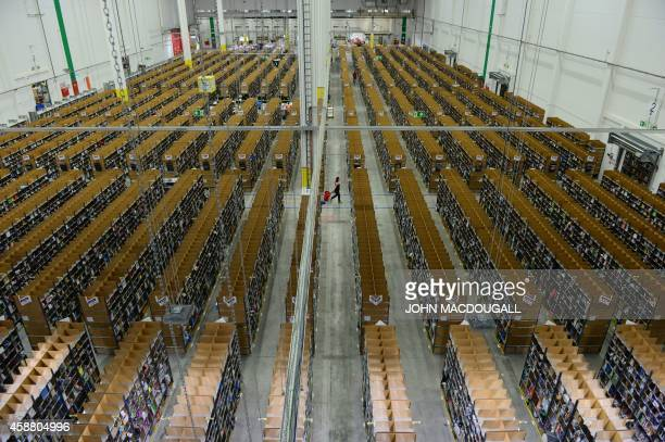 A general view shows the storage shelves at US online retail giant Amazon's Brieselang logistics center west of Berlin on November 11 2014 The center...