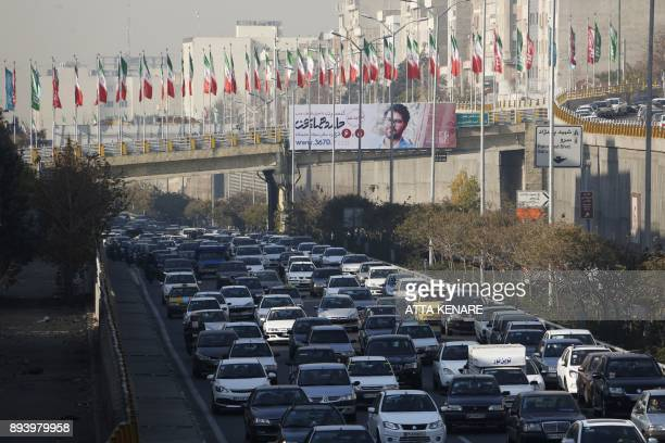 A general view shows the street traffic as winter's heavy pollution has hit new highs in the Iranian capital Tehran on December 17 2017 / AFP PHOTO /...