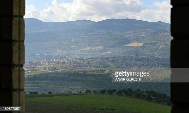 A general view shows the Syrian city of Jisr alShughur under the control of proregime troops near the border with Turkey on February 2 2013 After the...