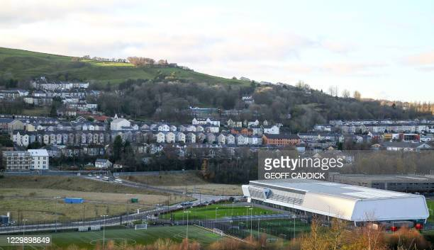 General view shows the town of Ebbw Vale, South Wales on November 26, 2020. - A huge silvery dragon brandishes its claws on the central square of...