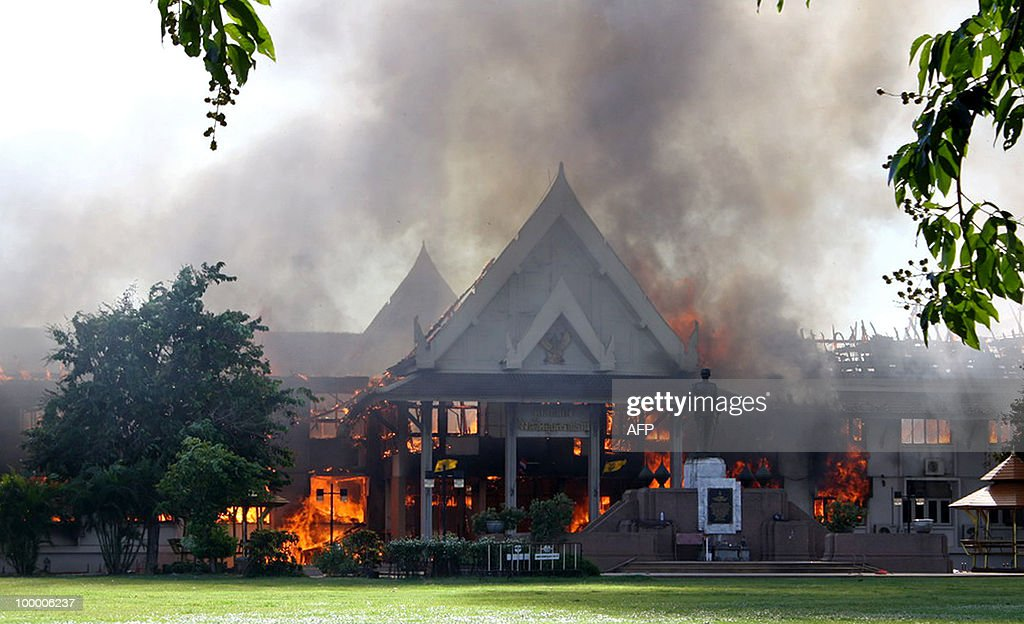 A general view shows the Ubon Ratchathani provincial hall set ablaze by anti-government protesters in Ubon Ratchathani province on May 19, 2010. Four provincial halls in Thailand's northeast, the heartland of anti-government protesters, have been torched as authorities struggle to halt violence in Bangkok from spreading, an official said. THAILAND