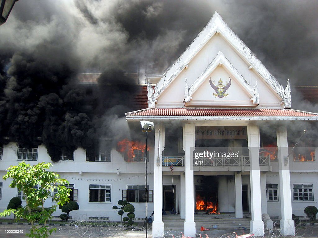 A general view shows the Udon Thani provincial hall set ablaze by anti-government protesters in Udon Thani province on May 19, 2010. Four provincial halls in Thailand's northeast, the heartland of anti-government protesters, have been torched as authorities struggle to halt violence in Bangkok from spreading, an official said. THAILAND