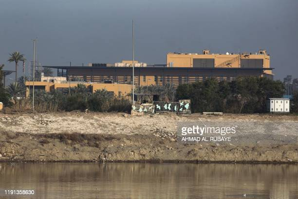 A general view shows the US embassy across the Tigris river in Iraq's capital Baghdad on January 3 2020 The US embassy in Baghdad urged American...