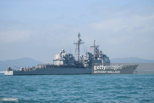 General view shows the US Navy's USS Chancellorsville guided missile destroyer during a joint port visit with the USS Ronald Reagan aircraft carrier...