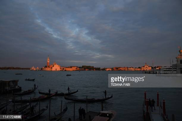TOPSHOT A general view shows the Venetian Lagoon and the San Giorgio Maggiore island and church within the 58th International Art Exhibition of the...