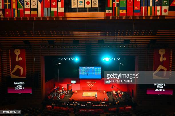 General view shows the venue of the women's 49kg weightlifting competition during the Tokyo 2020 Olympic Games at the Tokyo International Forum in...