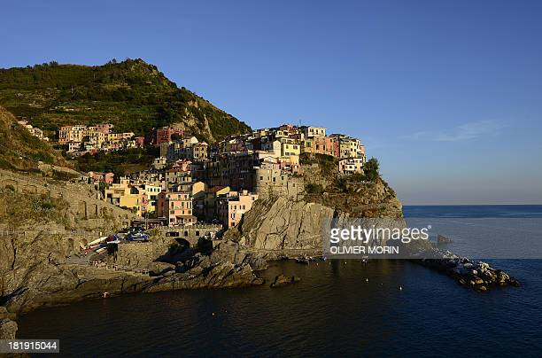 A general view shows the village of Manarola in the 'Cinque Terre' area on September 23 2013 Wine picking is atypical due to the steep land close to...
